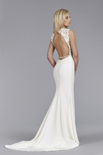 Style JH8460  Ivory Silk Crepe modified A-line bridal gown, Alencon lace bodice, drop waist, open back with crystal trim detail chapel train.