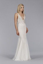 Style JH 8452  Ivory Cashmere English net modified A-line bridal gown, Platinum sequin bodice with V-neckline front and back, natural waist, sparkle net skirt, sweep train.