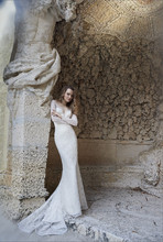 8507  Ivory Alencon lace modified A-line bridal gown, long sleeve, off the shoulder neckline, illusion sheer back with button detail, sweep train.