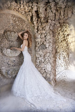 8509  Ivory Tuileries organza bridal gown, strapless sweetheart neckline, asymmetrical draped elongated bodice, sweep train.