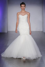 8510  Ivory beaded laser cut elongated bodice, strapless sweetheart neckline, pleated tulle skirt, sweep train.