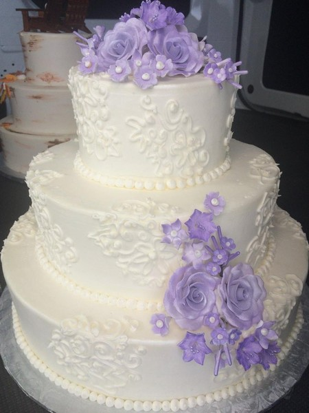 600x600 1459908559408 hand piped lace and purple sugar flowers