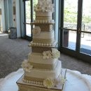130x130 sq 1335724282525 claudiaandgeoweddingcake012