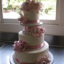 130x130 sq 1348275256856 lauraandmichaelweddingcakepicture006
