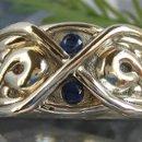 130x130 sq 1218751991716 customhandmadejewelry 14kwhitehandcarvedinfinityringwithbluesapphires