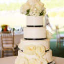 A four-tiered fondant-frosted cake was cut for dessert.  Cake:Russell Morin Catering & Events