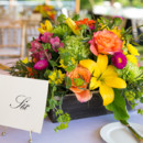 Tables were decorated with white linens and napkins, wooden box centerpieces, and easel numbers, surrounded by chiavari chairs.  Reception Venue:Jonathan Edwards Winery  Event Planner: Heidi Connister  Floral Designer:Sharon Elizabeth's Floral Designs LLC