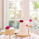 In addition to one wedding cake, there was also two mini wedding cakes.   Cake: Ashley Bakery