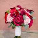 Her bouquet featured peonies, roses, and calla lilies.   Floral Designer: Country & Lace Florist