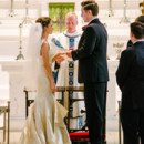 The couple exchanging vows.  Ceremony Venue:St. Mary's of the Annunciation Catholic Church