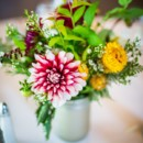 The centerpieces featured an assortment of wildflowers.  Venue/Caterer: BruMar Estate  Floral Designer: Conrad Floral and Swan River Gardens and Nursery