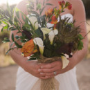 The bouquets featured roses, calla lilies, and wild greenery.   Naiya's Attire: Maggie Sottero