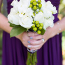 The bridesmaid's bouquets featured roses and berries.  Venue:Bali Hai Restaurant  Floral Designer:Archibald Flowers