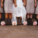 They also accessorized with matching cowboy boots.  Venue:The Edwards Barn