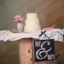 A three-tiered buttercream-frosted cake was cut and served for dessert.  Venue:The Edwards Barn