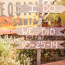 Guests were greeted with directional wooden arrows.   Venue:The Edwards Barn