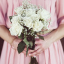 They carried bouquets of roses and baby's breath.  Floral Designer:FiftyFlowers
