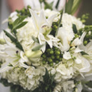 The bouquet featured hydrangeas, lilies, and berries.  Venue:Dover Hall Estate  Event Planner:LK Events and Design