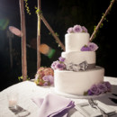 A three-tiered buttercream-frosted wedding cake was cut and served for dessert concluding dinner.