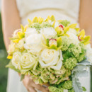 The bouquet featured roses, lilies, and hydrangeas.   Dress Designer:David's Bridal  Sash: 31 Bits  Floral Designer: Theresa Smith