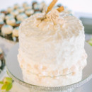 The mini buttercream-frosted cake was cut and served concluding dinner.   Reception Venue/Caterer: Harborside Restaurant