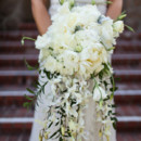 This cascading bouquet featured peonies, roses, lilies of the valley, and greenery.  Floral Designer: Sonoma Spring Flowers