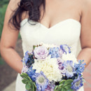 The bouquet featured roses, dahlias, gerber daisies, and succulents.