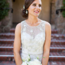 The bride wore a sweetheart sheath wedding gown with an illusion neckline, accessorized with her hair in an updo.  Venue: Sonoma Golf Club  Event Planner:A Savvy Event  Hair Stylist: Salon 171  Makeup Artist: Wallett Weddings  Floral Designer: Sonoma Spring Flowers