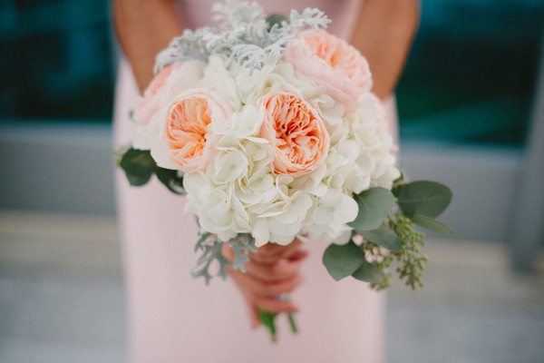 the bouquets featured garden roses hydrangeas and dusty miller bridesmaid dresses pats