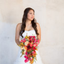 The bride wore a ball gown with a sweetheart neckline, accessorized with her hair half-up/half-down in loose curls.  Venue:Silver Horse Winery  Makeup Artist:The Queen Bees