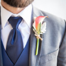 The boutonnieres featured calla lilies and dusty miller.  Venue:Silver Horse Winery