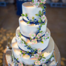 The four-tiered fondant-frosted cake was cut and served concluding dinner.   Venue: Silver Horse Winery  Venue: Silver Horse Winery  Cake: The Cakery