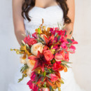 The bouquet featured roses, lilies and greenery.  Venue:Silver Horse Winery