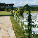Aisle markers hung on shepherd's hooks.  Venue:Tennessee RiverPlace  Event Planner:Soirees of Chattanooga  Floral Designer: Gil & Curt  Rentals:Showtime Event Rentals, IncandSound Force