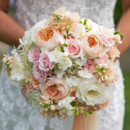 The bouquets featured garden roses, rice flower, stock, and freesia wrapped with ribbons around the stems.  Dress Designer:Allure Bridals  Floral Designer:Seaberry Farm