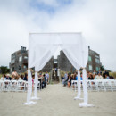 The couple was married right on the sand beneath a sheer draped structure.  Venue:Pajaro Dunes Resort  Rentals:Alexis Party Rental