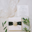 The invitation suite included a pearl brooch.  Invitations: Hiptwist