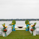 Due to unexpected rain, the ceremony was moved inside.  Venue/Caterer:Belle Mer  Floral Designer:Flowers by Semia