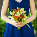 The bridesmaids carried bouquets of green cymbidium orchids, orange calla lilies, and fern curls.  Venue:Atwood Ranch  Event Planner:Julie Atwood Events  Floral Designer: Anne Appleman Flowers & Plants  Bridesmaid Dresses: J.Crew