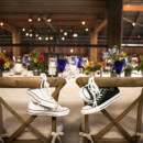 Comfortable sneakers awaited the bride and groom when they took their seats at the reception!  Venue:Atwood Ranch  Event Planner:Julie Atwood Events    Floral Designer: Anne Appleman Flowers & Plants