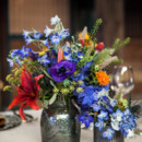 The tabletops were topped in colorful blooms like anemones, amaryllis, delphinium, and saffron.  Venue:Atwood Ranch  Event Planner:Julie Atwood Events  Floral Designer: Anne Appleman Flowers & Plants