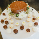 A mini chocolate buttercream-frosted cake was served concluding a buffet-style dinner.  Cake:Sugar Pine Cakery