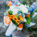 The bouquets featured roses, calla lilies, berries, green trick, and delphinium.   Venue: Sugar Bowl Resort