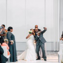 But first let the newlyweds take a selfie!  Venue/Caterer:Above  Event Planner: Jennifer Finch  Dress Designer:Maggie SotterofromRK Bridal  Hair and Makeup Artist:Juicy Looks by Abby  Groom and Groomsmen Attire: Men's Wearhouse  Officiant: Donald Rustin