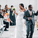 The high-fiving recessional.  Venue/Caterer:Above  Event Planner: Jennifer Finch  Dress Designer:Maggie SotterofromRK Bridal  Hair and Makeup Artist:Juicy Looks by Abby  Groom and Groomsmen Attire: Men's Wearhouse  Officiant: Donald Rustin
