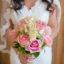 The bride carried a bouquet of Queen Anne's lace and pink and ivory roses embellished with pearl pins.  Venue: Shady Wagon Farm  Event Planner: Happily Ever After  Hair and Makeup: Made-Up Special Events Makeup  Floral Designer: Skyland's Florist