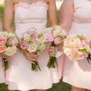 The bridesmaids paired their pretty pink dresses with romantic bouquets of roses and Queen Anne's lace.  Venue: Shady Wagon Farm  Event Planner: Happily Ever After  Floral Designer: Skyland's Florist