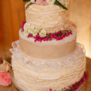 A rustic three-tier cake decorated with mini pearls, lace, burlap, flower, and ruffles.  Venue:Shady Wagon Farm  Event Planner:Happily Ever After  Floral Designer: Skyland's Florist  Catering:Cook Shack Catering