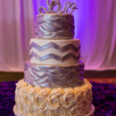 A four-tiered buttercream-frosted cake was cut concluding dinner.  Cake:Cupcake Chateau