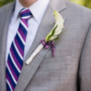 The groom wore a gray suit, accessorized with striped tie.  Floral Designer:Belovely Floral & Event Design
